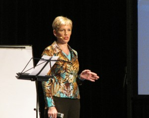 Mari Smith on stage at T. Harv Eker's Guerrilla Business School